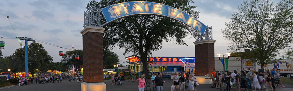 Photo of the main gate from inside the fairgrounds, guests entering the fair