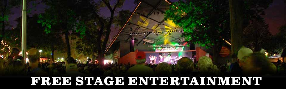 Photo of free entertainment at the Leinie Lodge Bandshell with the crowd watching under the stars.