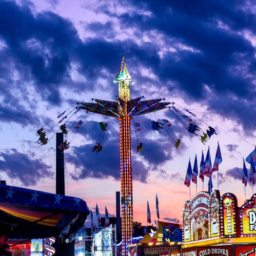 Midway lights with sunset backdrop